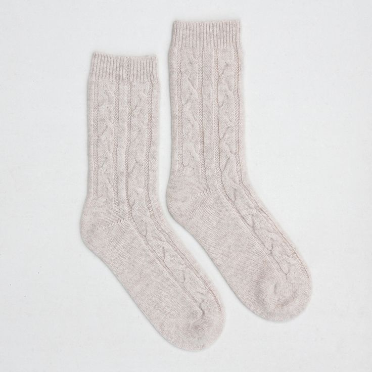 Cosy and perfect for winter these cable knit cashmere bed socks are a great gift for you or someone special. The cable knit gives pattern gives a luxurious look and the 100% cashmere wool gives a super soft feel. The perfect gift for him or her this season