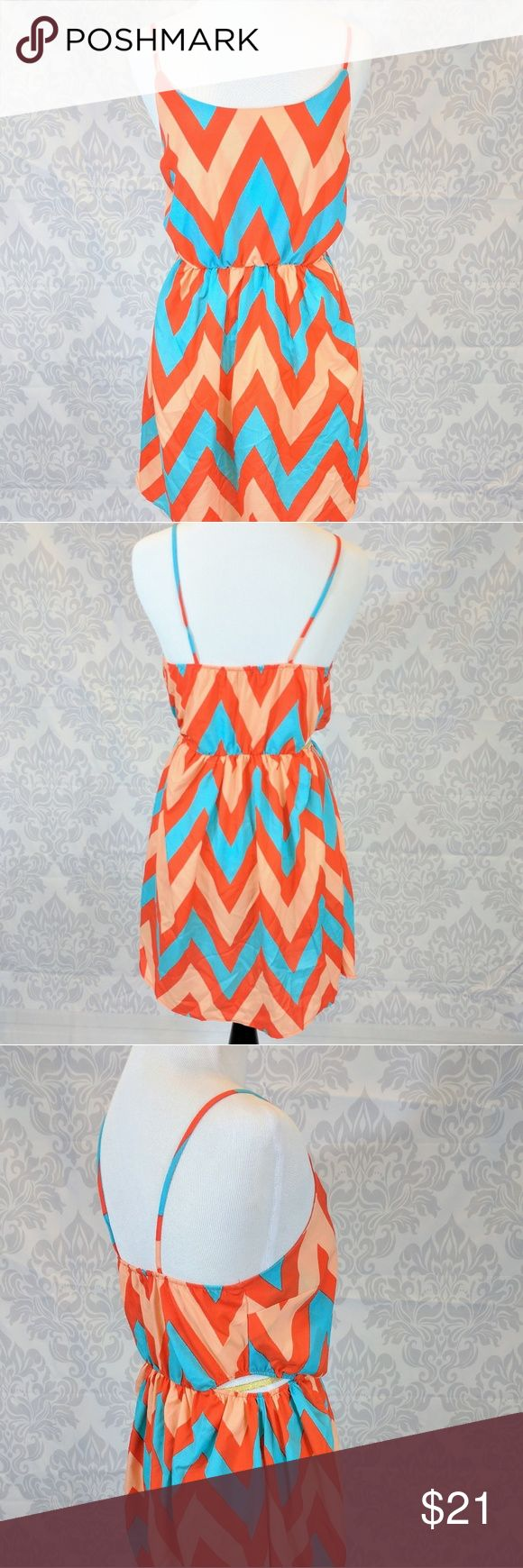 TINLEY | side cutout Chevron sundress Boutique brand Tinley, Coral orange and turquoise Chevron stripe sundress with cutout at side waist.   APPROXIMATE MEASUREMENTS:  Flat across bust: 16 inches Flat across waist: 11 inches (unstretched). Stretches to: 16 inches shoulder to waist: 16 inches Waist to hem: 17.5 inches tinley Dresses Mini