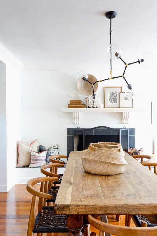 Love the rustic dining table with contemporary fixture