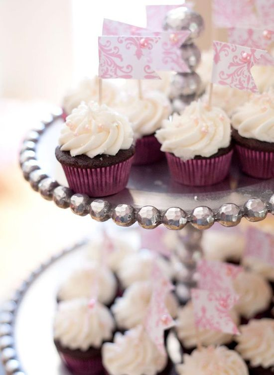 these adorable mini cupcakes are the perfect bite sized treat to keep your special day full of smiles! view more of the delicious desserts that Coveted Cakery offers, here. http://www.weddingchicks.com/vendor-guide/coveted-cakery/