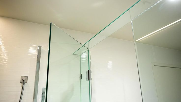 A frameless shower screen looks great with a glass top