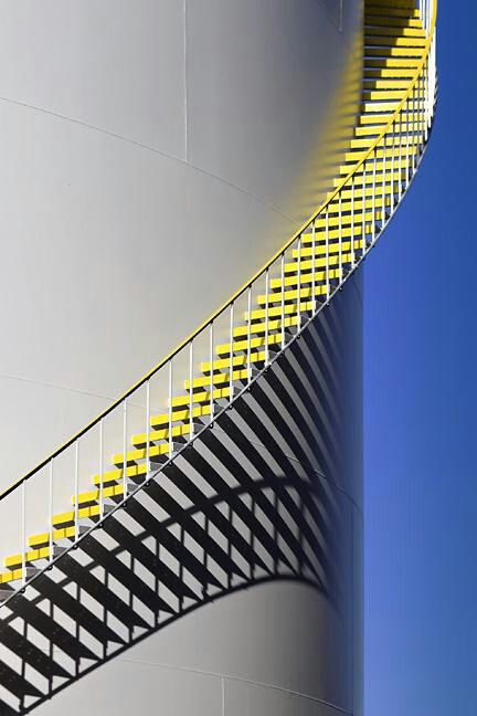Very unique yellow stairs on a tower.