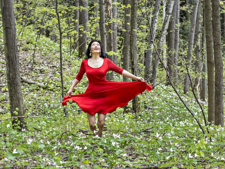 Viviane in Trillium Woods - Viviane wearing a red dress running in Trillium…