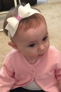 Große Schwester/kleine Schwester Baby Stirnband set. Ideal als Geschenk.  Bögen werden mit 100 % rosa/weiss Wollfilz an einem passenden Farbe super Weichbaby Stirnband gebildet. Bitte Nachricht an mich wenn Sie einem Filz oder anderen Anforderungen statt Glitter-Zentrum lieber.  Bögen-Messungen umfassen Schwänzen.  Größeren Bogen 4 Kleiner Bogen 3  Stirnband-Dimensionierung:  Neugeborenen - 13 Baby (3-6 Monate) - 14 Kleinkind 16 Kind - 17 Erwachsene/r-18