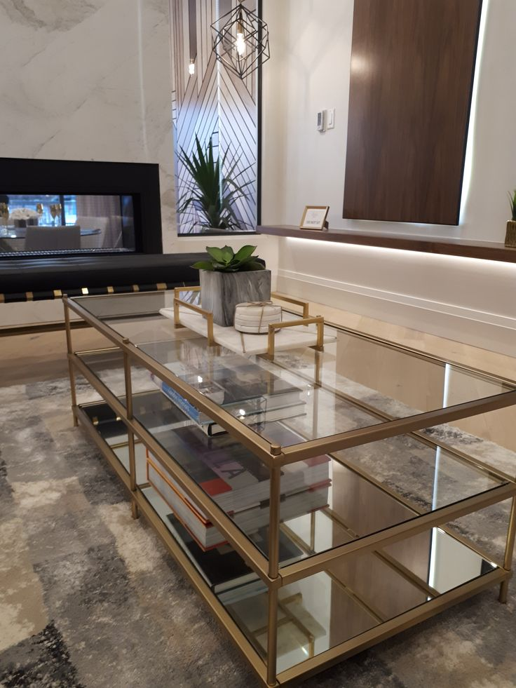 Love this glass and gold coffee table. The accents are just right.