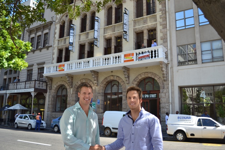 Mark Gedrych is in with another deal completed. He's sold a landmark free-standing heritage building in Spin Street in the Cape Town central business district for R13 million. The 2 200 square metre property was bought by an anonymous buyer.    Pictured above are Francois Staples and Mark Gedrych of Galetti in front of the property. — at Spin Street, Cape Town.