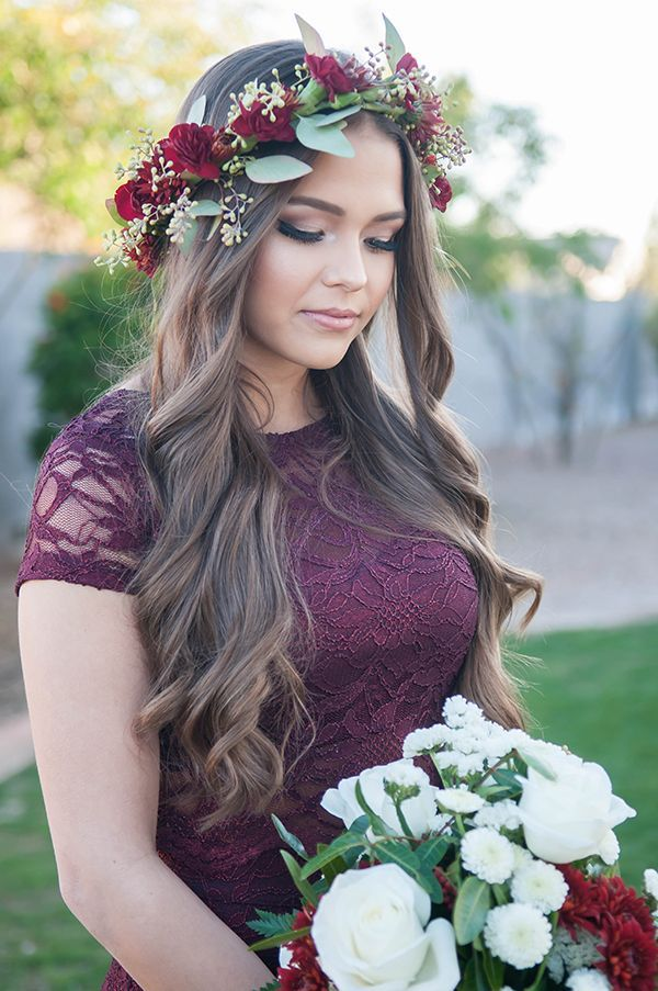 c79e62b348 Bridesmaid wearing a burgundy lace dress and a jewel-toned floral crown  made out of dahlias and seeded eucalyptus