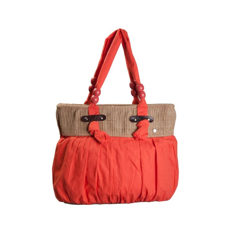 Designed in cotton voile, accessorized by Napa leather riveted into thick hydro carbon free jute, with the very usual voile handles laced with hand-painted wooden rings; this shoulder bag is for the urbane woman with liking for rustic sophistication.  http://www.yologear.co.uk/bags-purses-wallets/shoulder-bags/luna-printed-coral.php