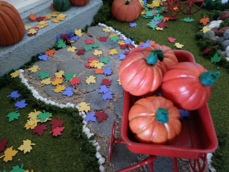 Painting the 1:12 scale polymer clay pumpkins makes them more real.