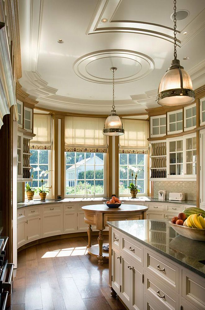 Gorgeous curved cabinetry, and curves everywhere!  Beautifully done.