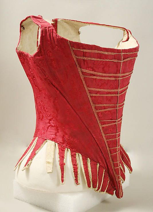 Bodice    Date:      1775–89  Culture:      European  Medium:      silk, leather, iron, baleen, linen  Dimensions:      Total Length (a): 22 1/2 in. (57.2 cm) Total Length (b): 15 in. (38.1 cm)