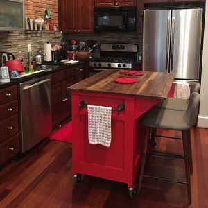Customizable Kitchen Island On Wheels For Countertop Or Storage; Has  Cabinetry, Spice Rack, Spice Holder, And Seating Area.