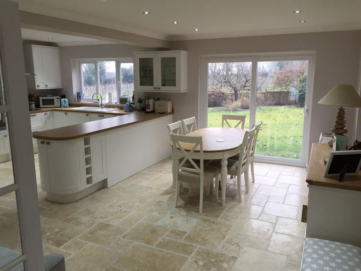We love this kitchen, sent in to us by a happy customer. It's been laid with our Rustic Travertine which we think looks cream with the cream cabinets and wooden worktops.