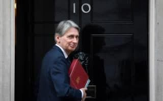 Comment: Britain's Chancellor of the Exchequer Philip Hammond arrives at 10 Downing Street in London, November 2, 2016