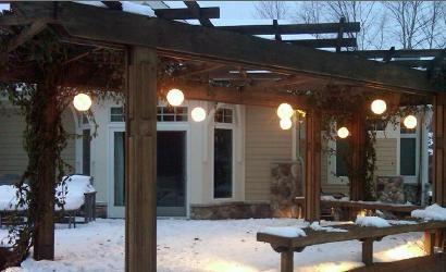 Hanging lanterns illuminate this outdoor pergola. Foegley Landscape, Inc. http://www.poolspaoutdoor.com/blog/entryid/42/outdoor-holiday-winter-decor-ideas.aspx