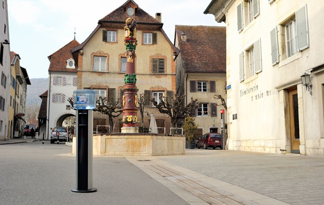 """HOME 11L Water cooler in front of the """"Fontaine de La Vierge"""" in Delemont - Jura"""