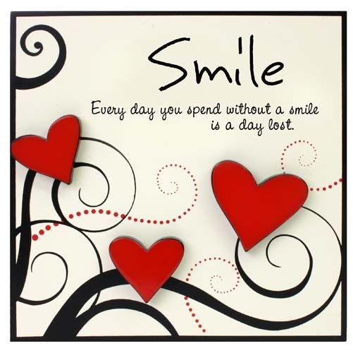 """Smile Plaque by Heartfelt Moments. """"Every day you spend without a smile is a day lost""""."""