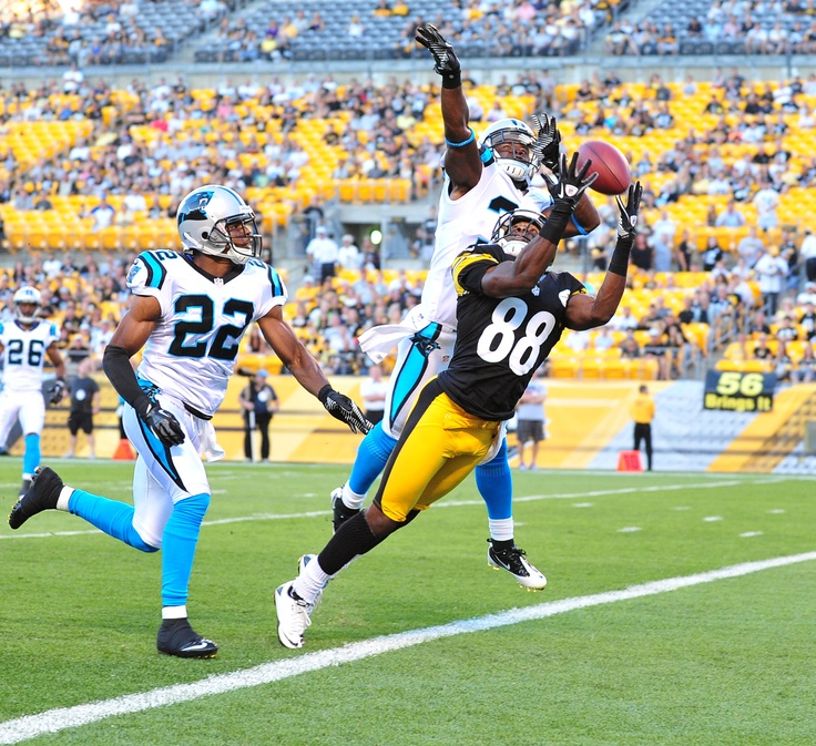 Steelers receiver Emmanuel Sanders beats the Panthers' Reggie Smith and Josh Thomas (22) for a first quarter touchdown on Thursday, Aug 30, 2012, at Heinz Field.  Chaz Palla | Tribune-Review