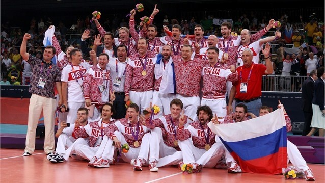 Russia celebrates with their gold medals after defeating Brazil in the fifth set of the Men's volleyball gold medal match on Day 16
