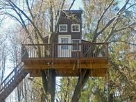 Atop a platform that doubles as a spacious deck, this Princeton, New Jersey treehouse from  Living Tree  was built in an oak tree for a family with three children. In addition to doors, windows, a roof and electricity, this project affords an equally stunning view of the ground and the sky.