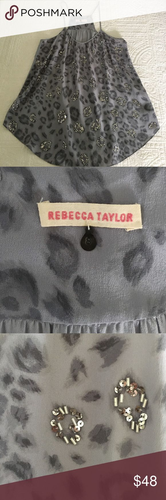 Rebecca Taylor animal print sequined top! Trendy and cute top- perfect for a night out! The lavender color is perfect for all seasons. Can be dressed up with a blazer and jeans, or with a shimmery shirt or skirt. Sequins on the cheetah print dress this top up. Such a fun piece! Rebecca Taylor Tops