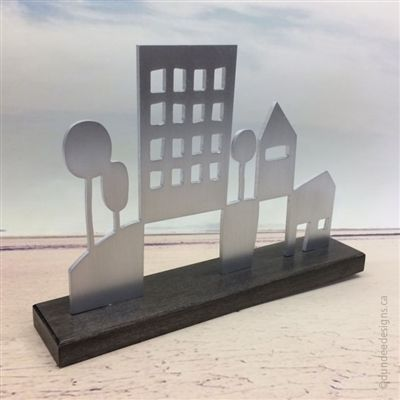 City/Rural sculpture: aluminum with maple base. Artist: Shirley Lloyd-Davies/Dundee Designs Inc.