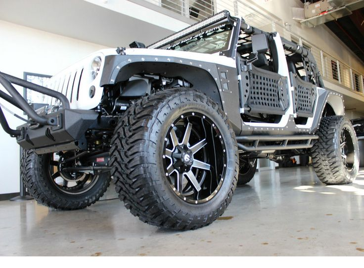 """This Jeep Wrangler is BONKERS! Check out it's  KEVLAR coated body, 38"""" tires and 22"""" wheels. You MUST check this out! Click on the image. #outrageousride #spon"""