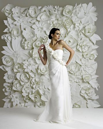 Beautiful white paper flower backdrop. Would love this for wedding reception head table.