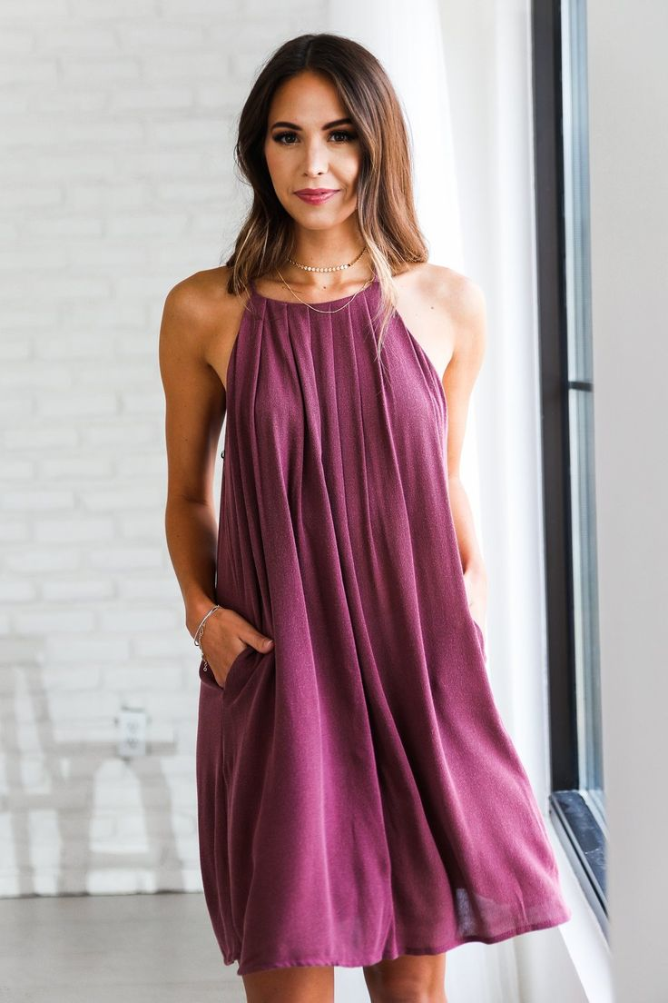 • Flowy burgundy spaghetti strap dress with pleated detail • Available in sizes S, M, L. Model is wearing a size small • 100% Rayon