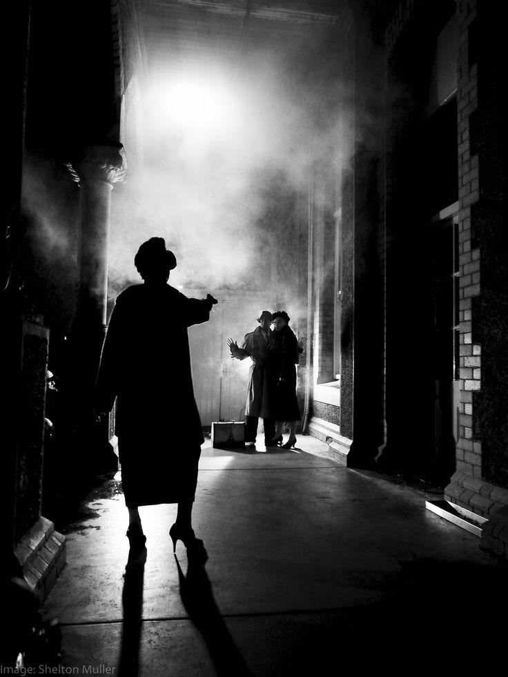 Film Noir mise en scène - strong light and shadows, fog, gun