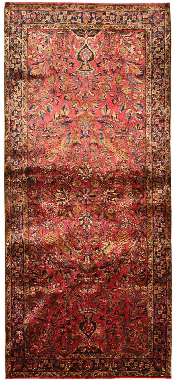 Antique Kashan Rug, Persia - an antique Kashan rug that was originally hand made in Persia. With rich reds, beautiful Persian blues, and luminescent golden-yellows that are accentuated by the velvety silk pile, this classic Kashan carpet features a central medallion and two peacock-flanked vases that exemplify the luxurious tastes and styles favored by the region. This antique rug is a genuine work of art, the impeccable craftsmanship.