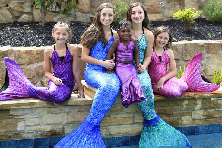 Brooklyn and Bailey and the McKnight girls show off their live mermaid costumes ...