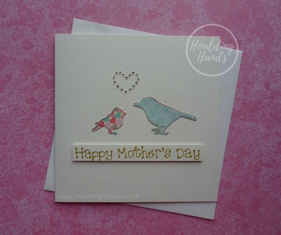 Unique handmade Mothers Day card, featuring a Mum and Daughter bird. This handmade card for Mum has the message: Happy Mothers Day.  This Happy Mothers Day card has the silhouette of a Mum (or Mom) bird and a baby bird in pretty patterned paper, with a gold foil shadow on each of them. There are gold round gems in the shape of a heart just above the two birds. The sentiment is added with 3D foam and reads: Happy Mothers Day  PERSONALISING YOUR CARD: You can choose the message on the front of…