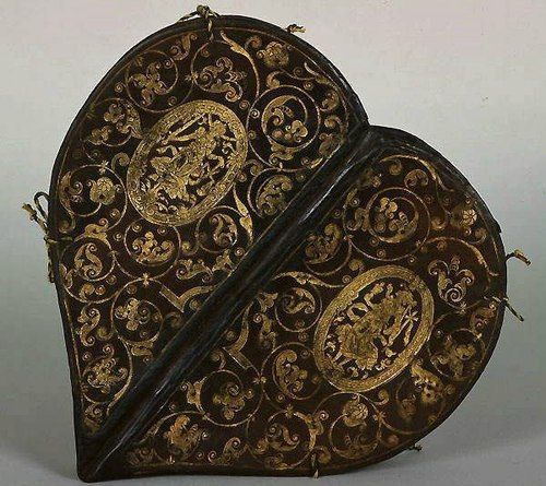Heart-shaped Prayer Book, circa 1580, gilt embossed leather cover. Attributed to Caspar Meuser, an apprentice and successor of Jakob Krause, the German bookbinder who was the first to use gold tooling and French & Italian designs in his binding. This book was designed for Anne of Denmark, the wife of Augustus I, Elector of Saxony.