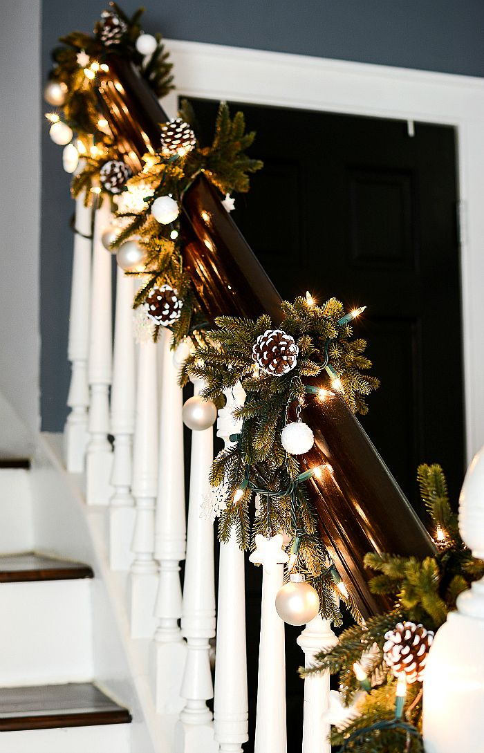 Garland on Stairs Decorated with Ornaments and Pine Cones