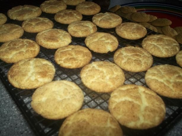 "Easy Snickerdoodles Cookies ~ 18 1/4 oz White Cake Mix, 1/2 c Butter melted, 1 Egg, 2 T Sugar, 1 tsp Cinnamon. Oven 350 (325 dark or non-stick). Mix cake mix, butter & egg till dough forms. Shape into 1"" balls (rounded teaspoonful), roll balls in cinnamon/sugar mix. Place 2"" apart on ungreased sheet. Bake 10-12 minutes or till set. Remove & cool on wire rack."