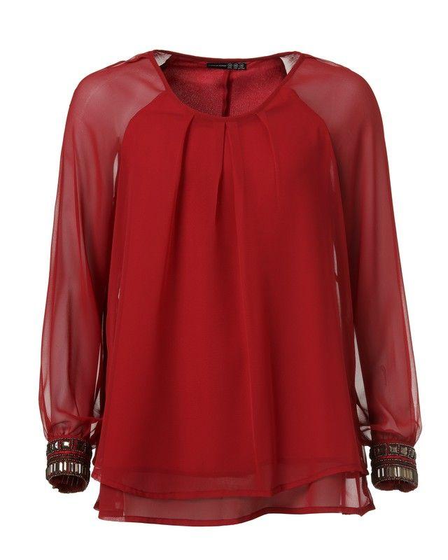 Blusa túnica roja con puños adornados 17 €, en tiendas a principios de octubre-Primark