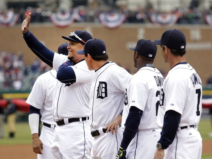 Detroit Tigers Miguel Cabrera waves to the fans as he is announced to the crowd during opening ceremonies prior to the Detroit Tigers game against the Minnesota Twins, Monday, April 6, 2015 in Comerica Park