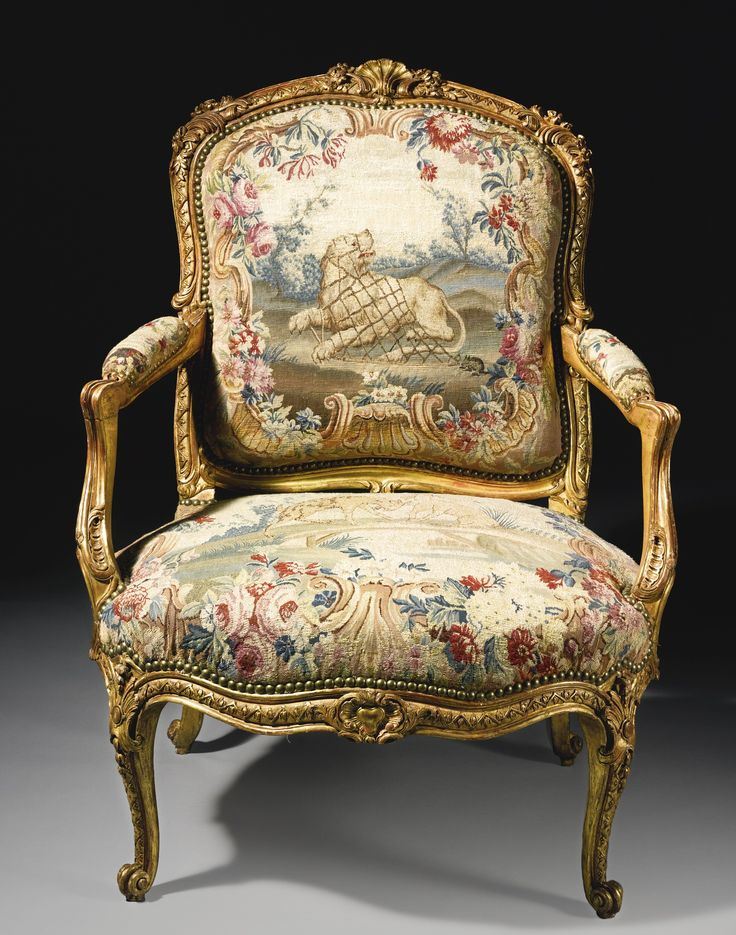A rare pair of Louis XV carved giltwood fauteuils, upholstered in eighteenth-century Beauvais tapestry and attributed to Jacques-Jean-Baptiste Tilliard, circa 1765.