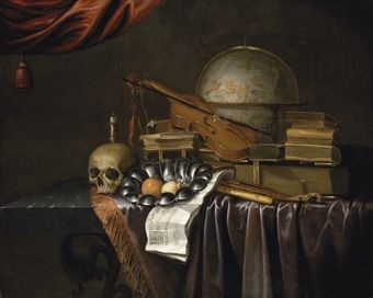 THE MONOGRAMIST 'JR', DUTCH 17TH CENTURY A VANITAS WITH A SKULL, AN ORANGE AND A LEMON IN A PEWTER BOWL, AN EXTINGUISHED CANDLE, BOOKS, MUSI...