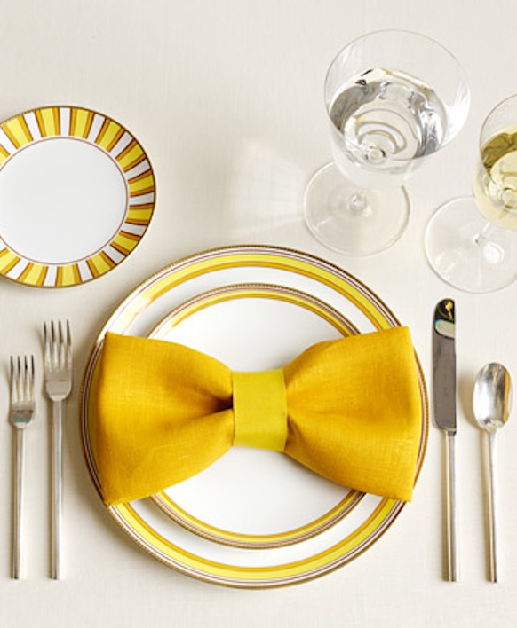 These napkins folded into bow ties are such an adorable way of adding some memorable style to your wedding reception tables.