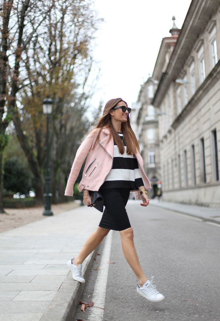 tube skirt, striped sweater and a pink jacket.
