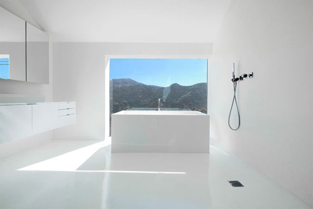 #minimal #white #bathroom.  why isn't the tub centered on the window?