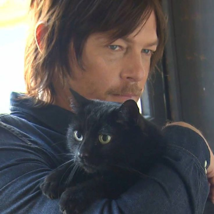 Norman Reedus with his black cat Eye in the Dark.