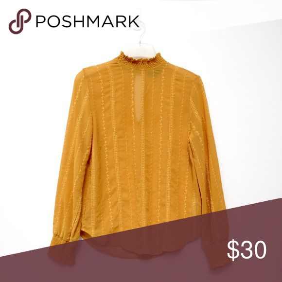 Mustard Yellow Topshop Blouse Long sleeve designed blouse with a semi-turtleneck, and rushed sleeves at the ends. Has a small slit like keyhole opening in the back, and two buttons above it. Topshop Tops Blouses