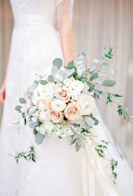 Brides.com: 25 Wedding Bouquets Full of Fresh and Fragrant Herbs This elegant-yet-natural bouquet by Carolyn's Flowers features trailing eucalyptus amongst the roses, ranunculus, and hydrangeas.Photo: Kate Holstein