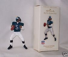 Hallmark Keepsake Ornament Football Legends Donovan McNabb #5 2006 #12 Series This figure is 4 3/4 in. tall, he is in a throwing  position .