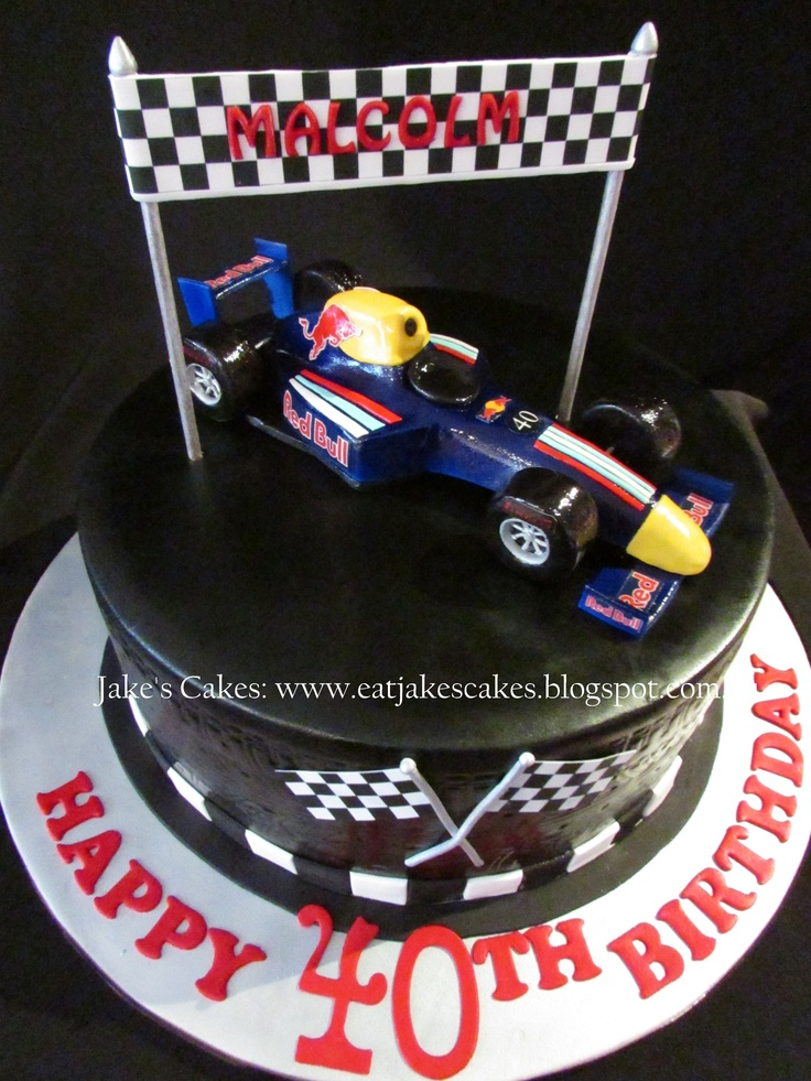 Red Bull formula one racing car cake! Racing car totally handmade by me out of fondant and was at least a week in the making in a several stage process, its about 10(25cm) inches long. Its totally edible except for some toothpicks holding the wheels on. Choc mud cake with chocolate ganache.
