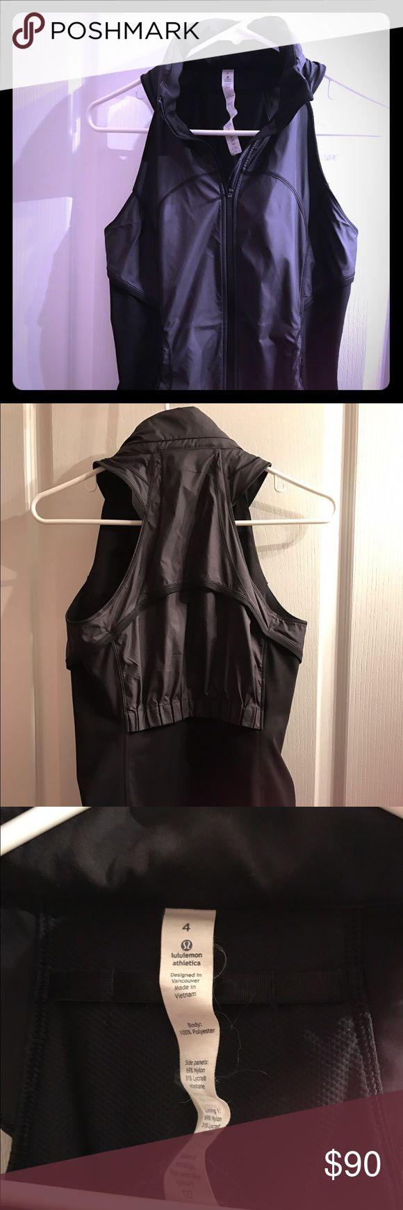 Lululemon Vest Size 4 Lululemon Black Vest Size 4. Fitted Vest with zipped hood. Worn 2x. lululemon athletica Tops