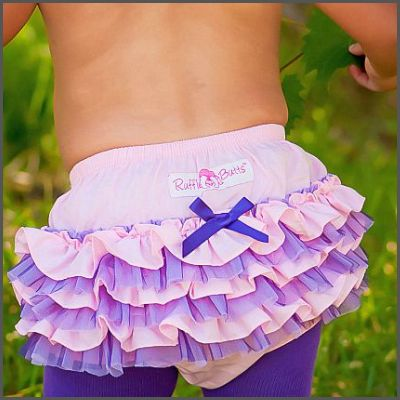 Pink & Purple Tutu Ruffle Butt. For your little ballerina! This tutu-inspired ruffle bloomer offers a fun and unique style of ruffles for that adorable little booty! With it's feminine and frilly style, this little bloomer offers a touch of innocence to any outfit! Matched with our Purple Ruffled Tights, she will look divine!